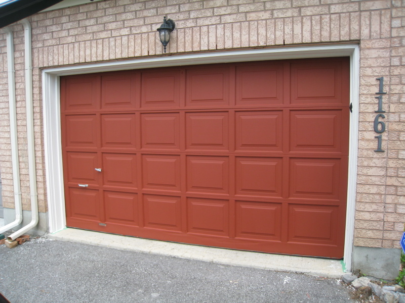 Brown garage door after being painted