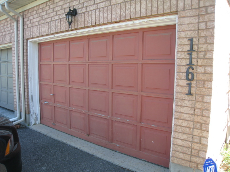 Brown garage door in need of paint